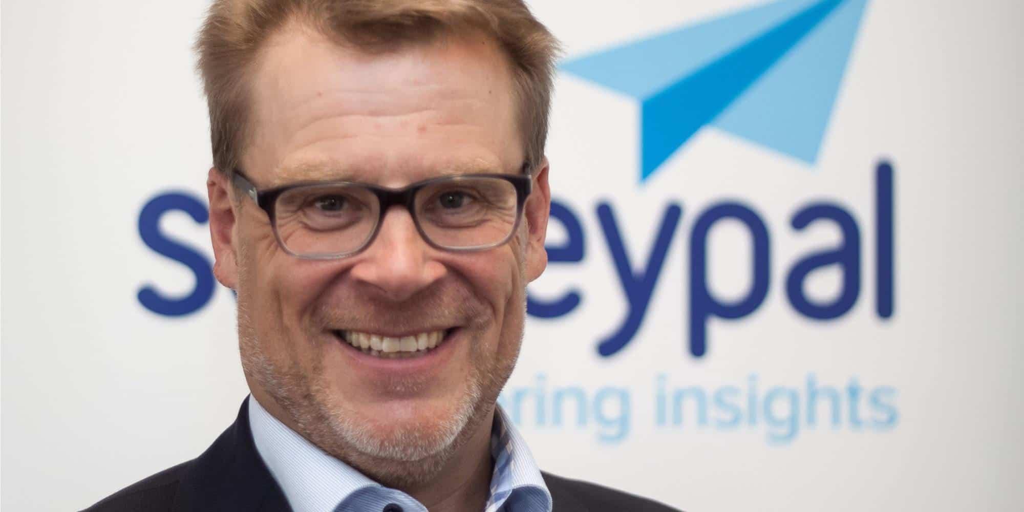 Surveypal CEO Tom Toivonen smiling at camera