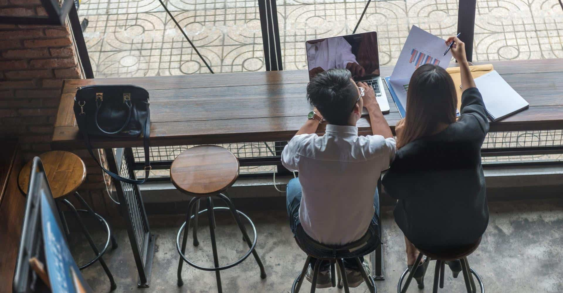 Two people collaborating in a coffee shop